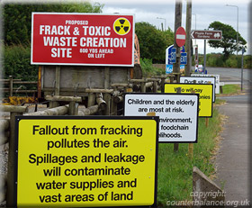 A clutch of anti fracking signs