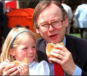Rt Hon John Gummer Feeds his daughter beefburgers in 1990